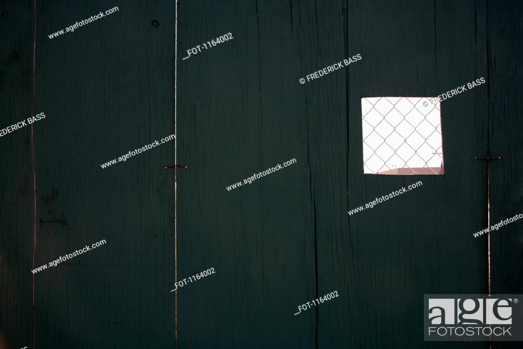 Stock Photo: Forced perspective of small wire mesh section of fence.