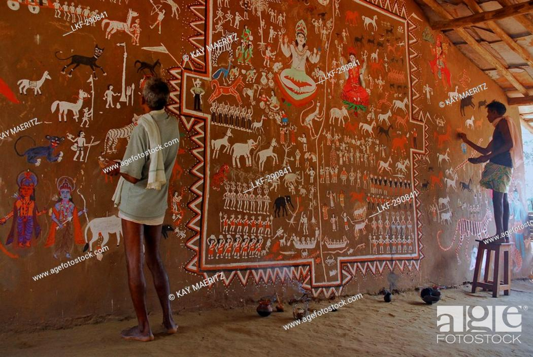 Stock Photo: Men painting tribal art on a wall in a ceremonial hall, Bastar, Chhattisgarh, India, Asia.