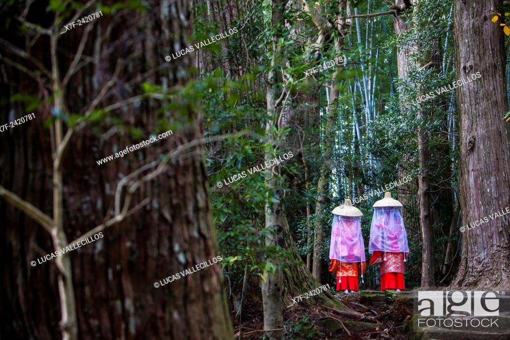 Stock Photo: Pilgrims in Heian period costumes, in Daimon-zaka Slope, access at Kumano Nachi Taisha Grand Shire, Kumano Kodo, Nakahechi route, Wakayama, Kinki, Japan.