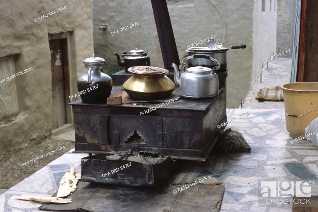 Stock Photo: Kitchen Stove with vessels , keylong , himachal pradesh , india.