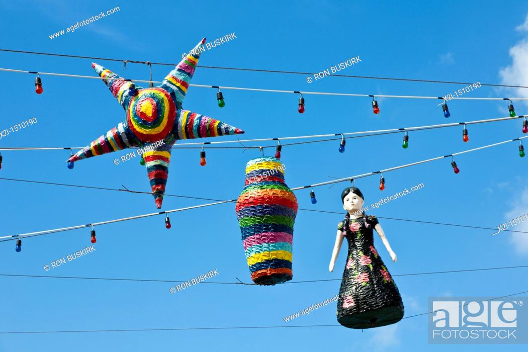 Stock Photo: Pinatas hanging on strings of lights against blues sky in Cozumel, Mexico in the Caribbean Sea.