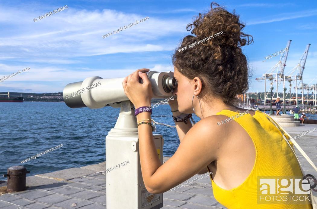 Stock Photo: Girl looking through binoculars, Koper, Slovenia.