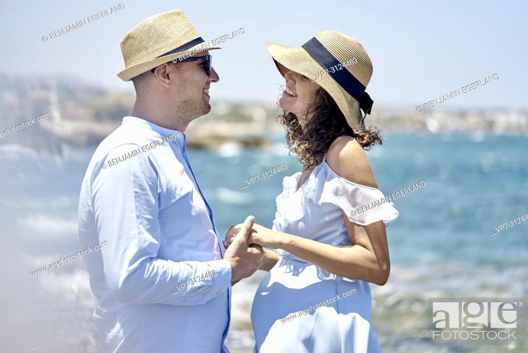 Stock Photo: couple enjoying holidays at seaside.