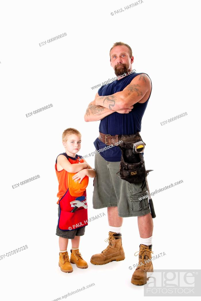Stock Photo: Caucasian middle aged father and cute young son ready to do a construction job  Man and boy wearing tool belt with hammer, shorts and boots.