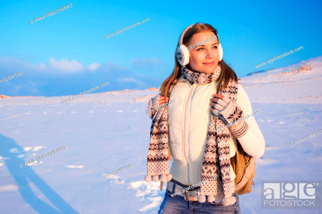 Stock Photo: Portrait of cute happy female spending winter holidays in the mountains, enjoying beautiful snowy view, healthy active lifestyle.