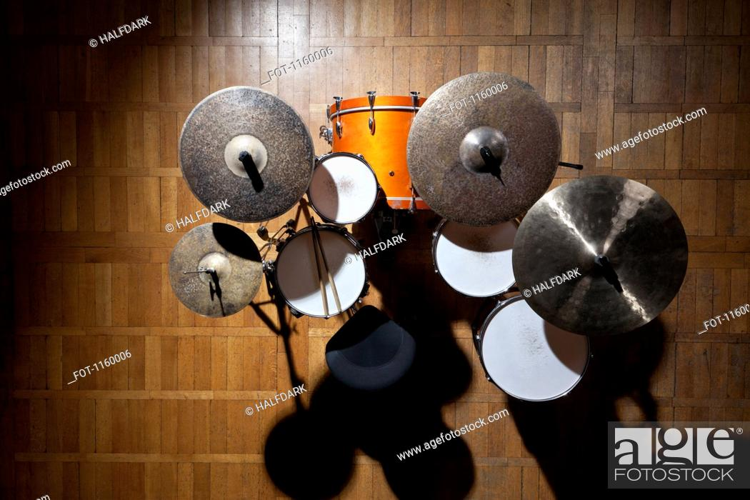 Stock Photo: Shadowed drum kit on stage in spotlight.