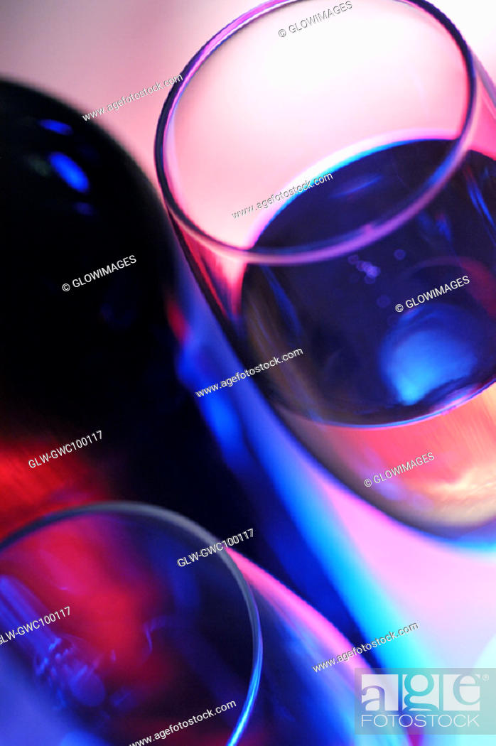 Stock Photo: High angle view of a wine bottle with two wineglasses.