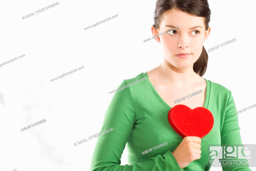 Stock Photo: woman holding heart.