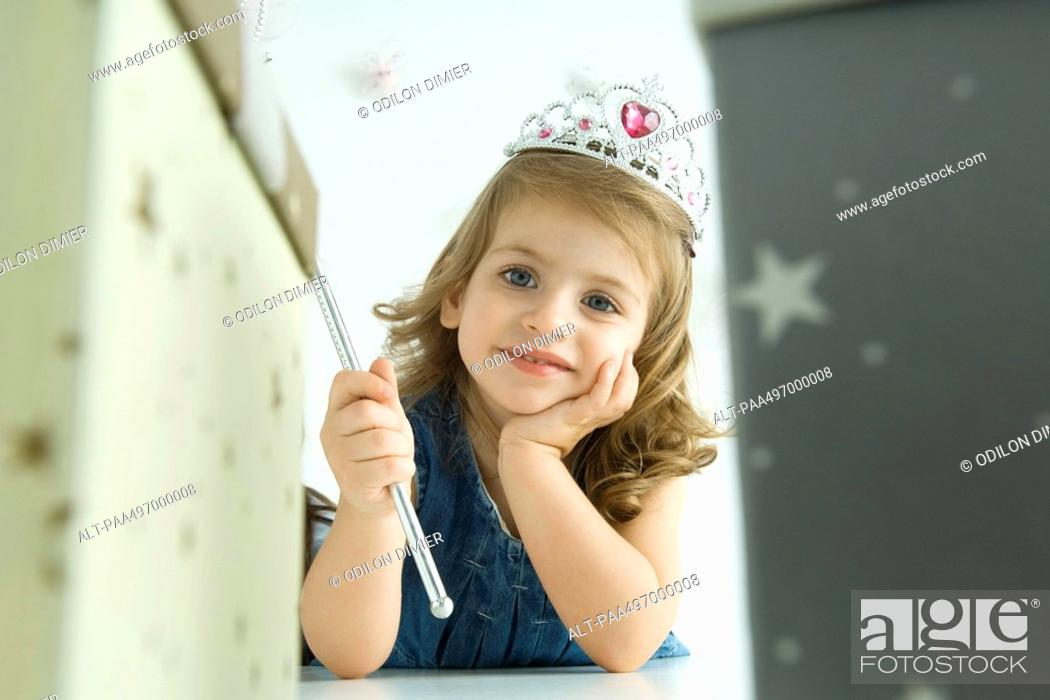 Stock Photo: Girl dressed as a princess, hand under chin.
