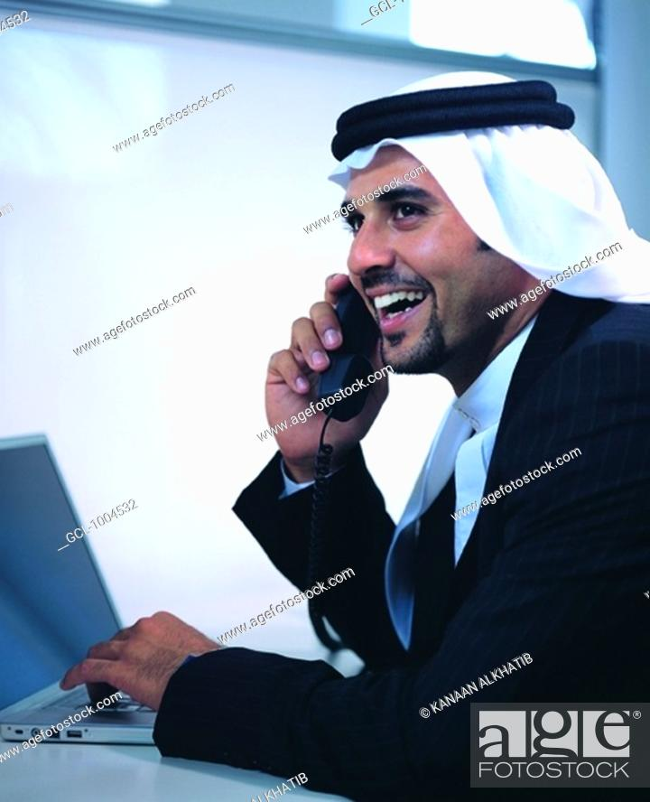 Stock Photo: Saudi Arabian businessman in the office.