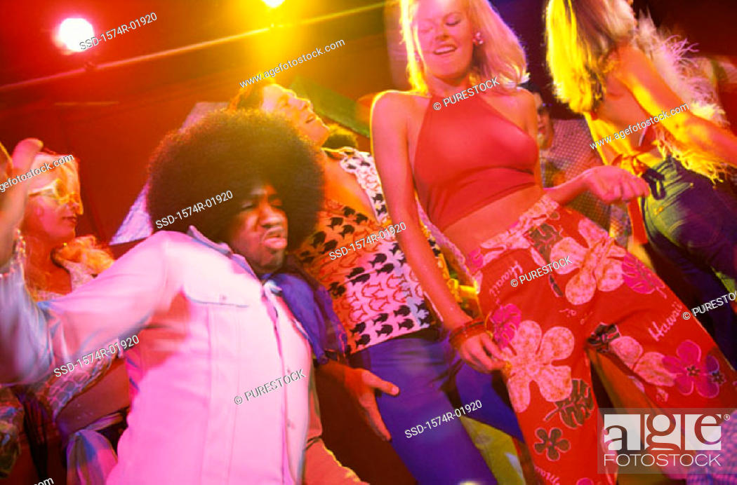 Stock Photo: Low angle view of young men and women dancing in a discotheque.