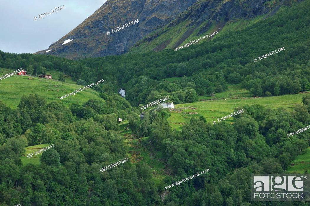 Stock Photo: Geiranger fjord, Beautiful Nature Norway. It is a 15-kilometre (9.3 mi) long branch off of the Sunnylvsfjorden, which is a branch off of the Storfjorden (Great.