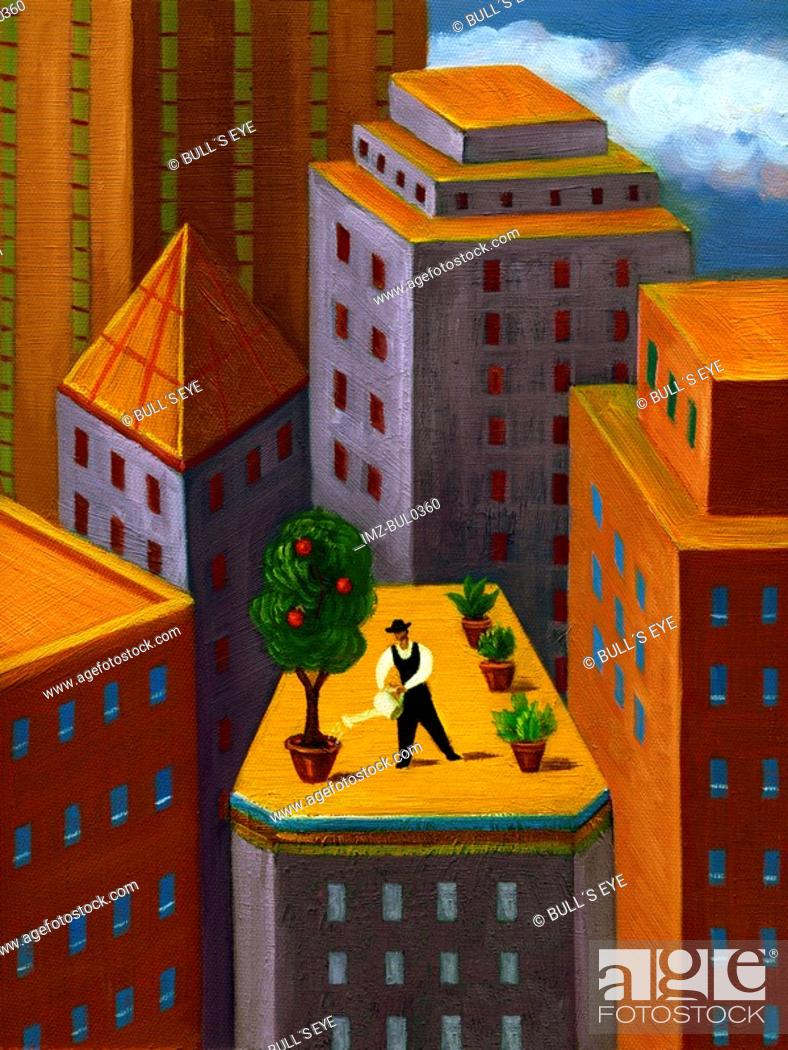 Stock Photo: A man watering a garden on top of a high rise building in the city.