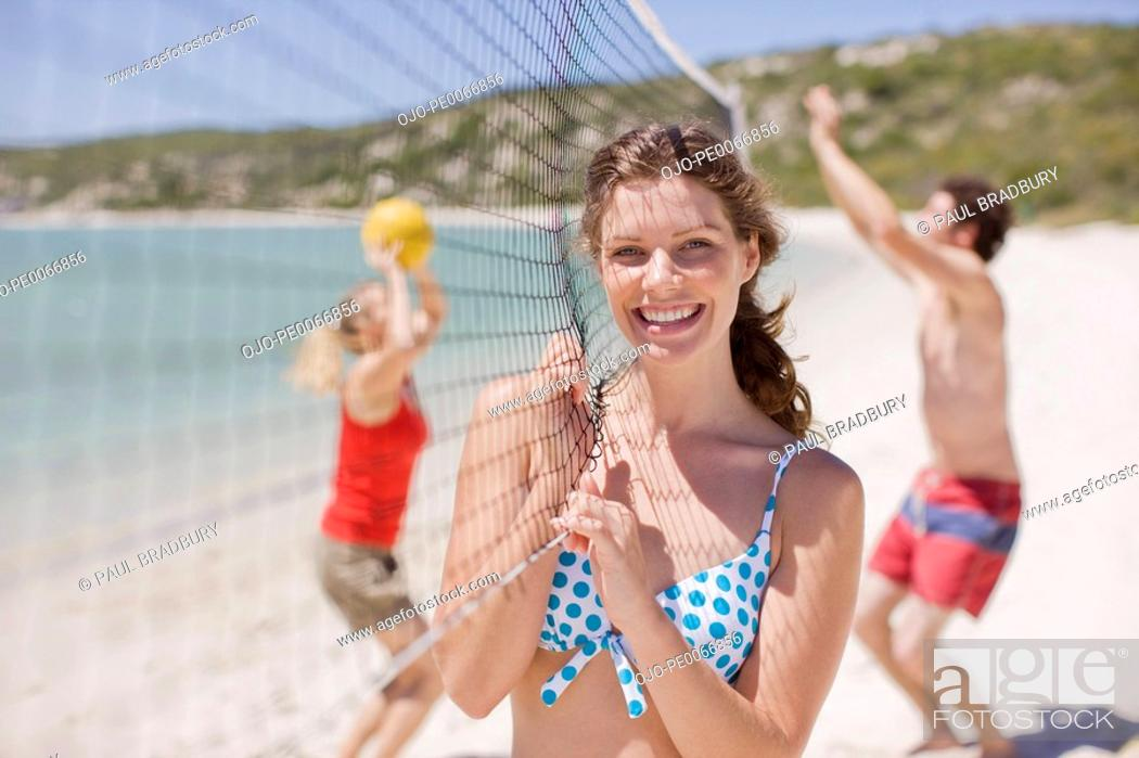 Stock Photo: Friends playing volleyball.