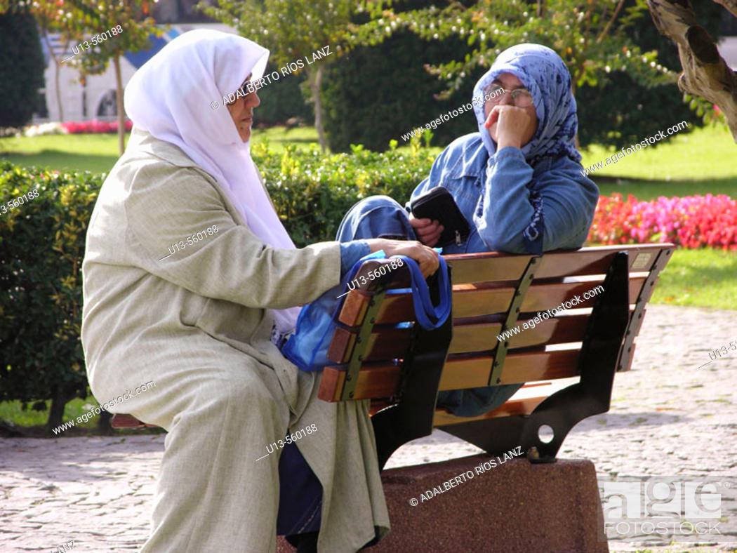 Stock Photo: Muslim Women Conversating in  Sultanahmet Park Istanbul Turkey.