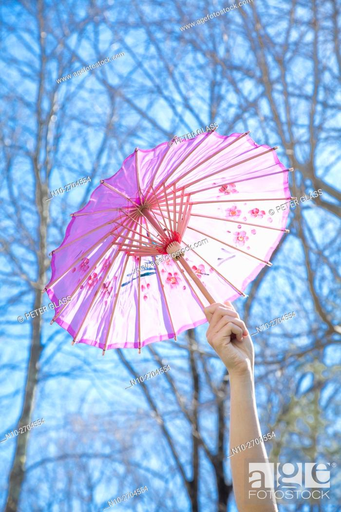 Stock Photo: Teenage girl outside, holding a parasol.