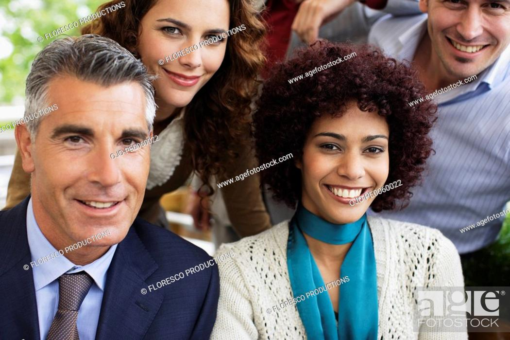 Stock Photo: Five businesspeople outdoors.
