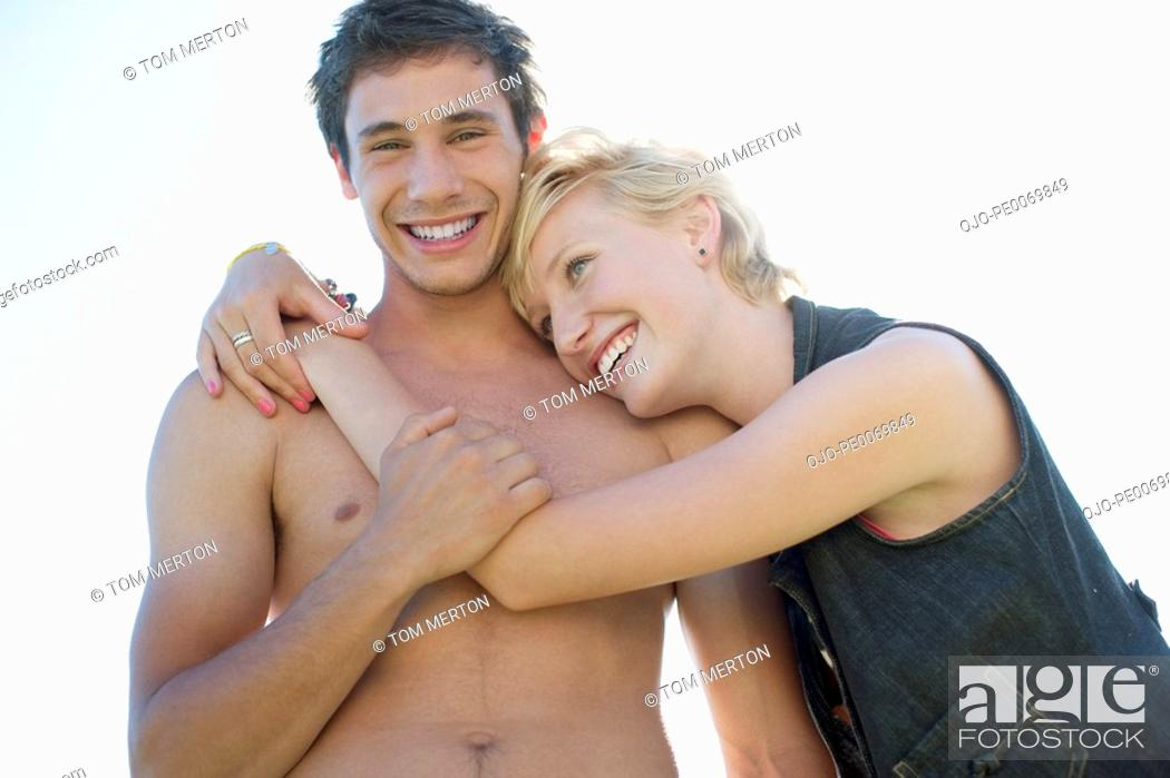 Stock Photo: Woman hugging man with bare chest.