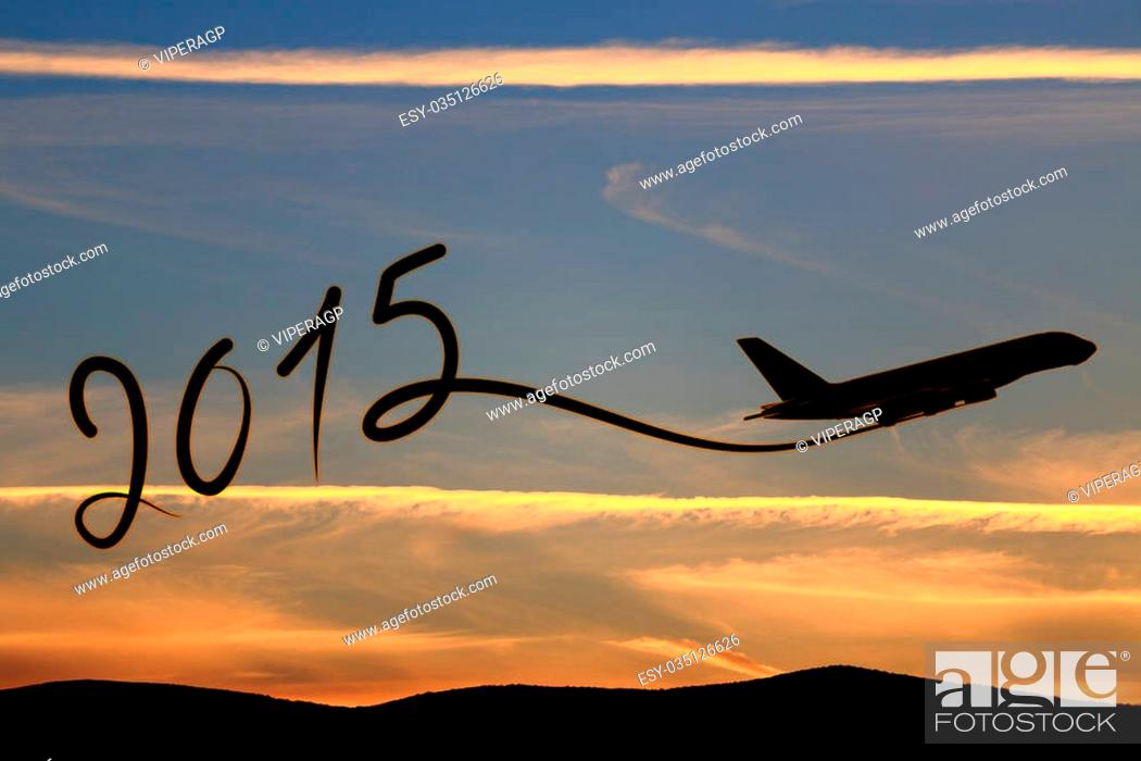 Stock Photo: New year 2015 drawing by airplane on the air at sunset.