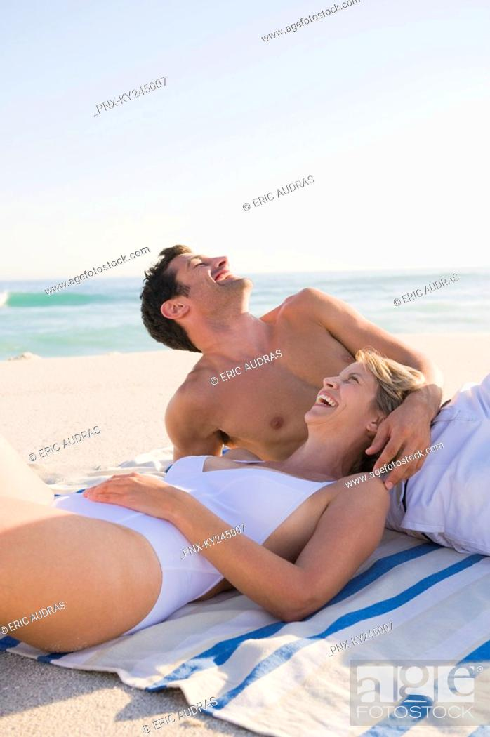 Stock Photo: Couple lying on the beach.