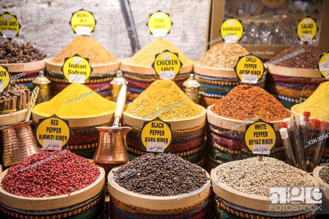 Stock Photo: Stocked baskets of savory spices on display for sale at Istanbul Spice bazaar in Turkey.