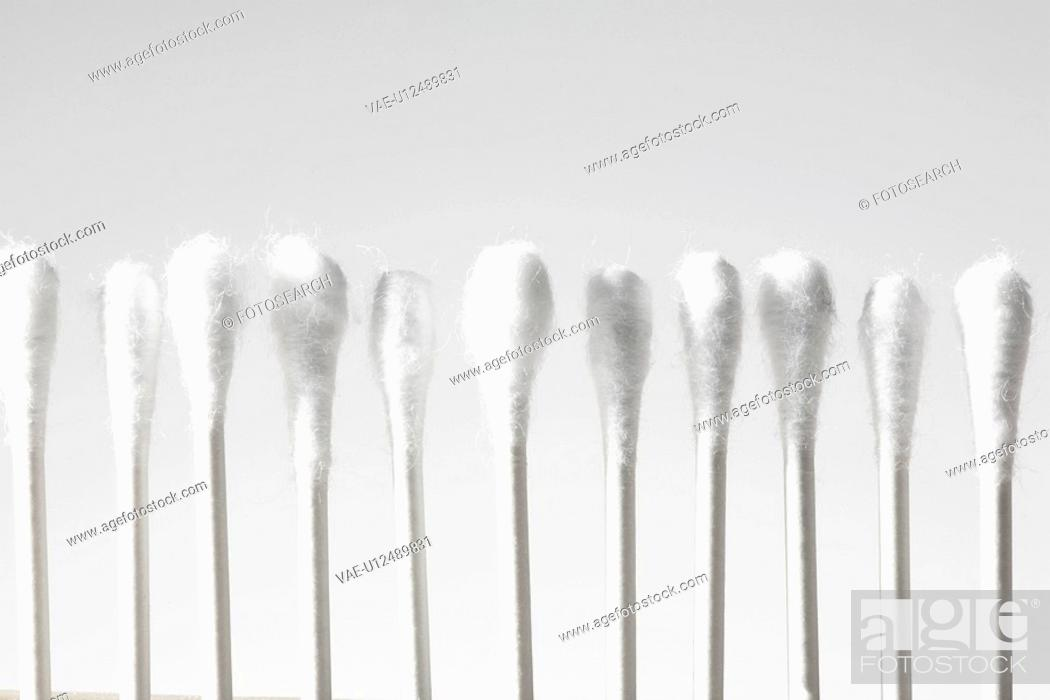 Stock Photo: Cotton swabs in row.