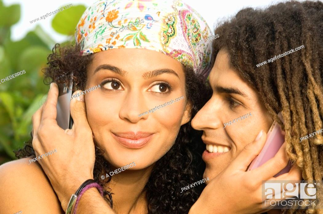 Stock Photo: Close-up of a couple using mobile phones.