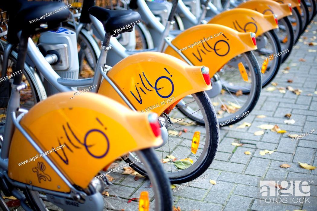 Stock Photo: Bikes of Villo, the public rental service of Brussels, Belgium.