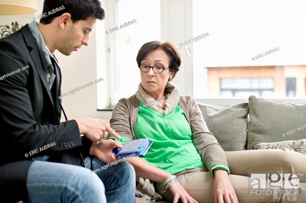 Stock Photo: Male doctor explaining about medicines to a patient.