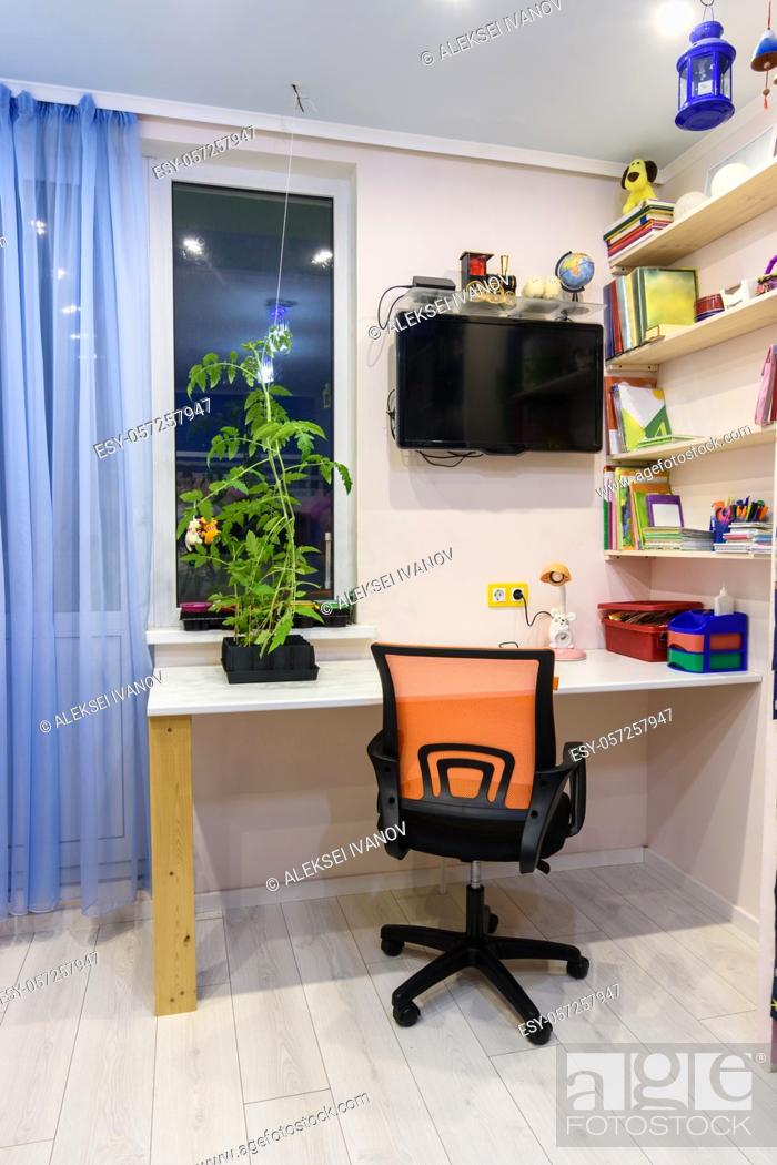 Stock Photo: Writing desk in the children's room, view of the desk located by the window.