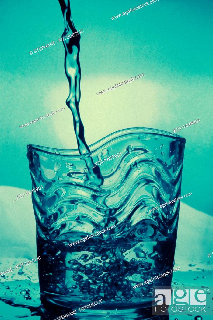 Stock Photo: Water glass, with water pouring.