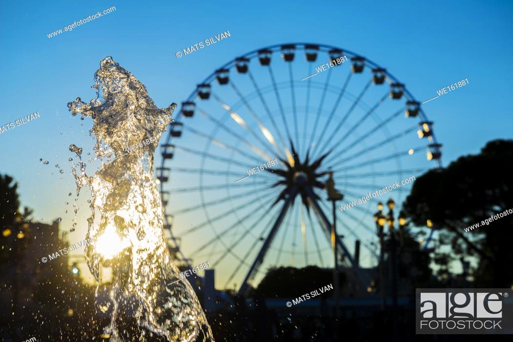 Photo de stock: Ferris Wheel and Water Fountain with Sunlight in Nice, France.