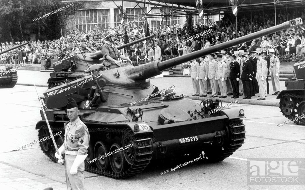 Stock Photo: Tanks drive past the spectators and the honorary tribune during the parade on the occasion of the French national day on the 14th of July in 1961 in the.