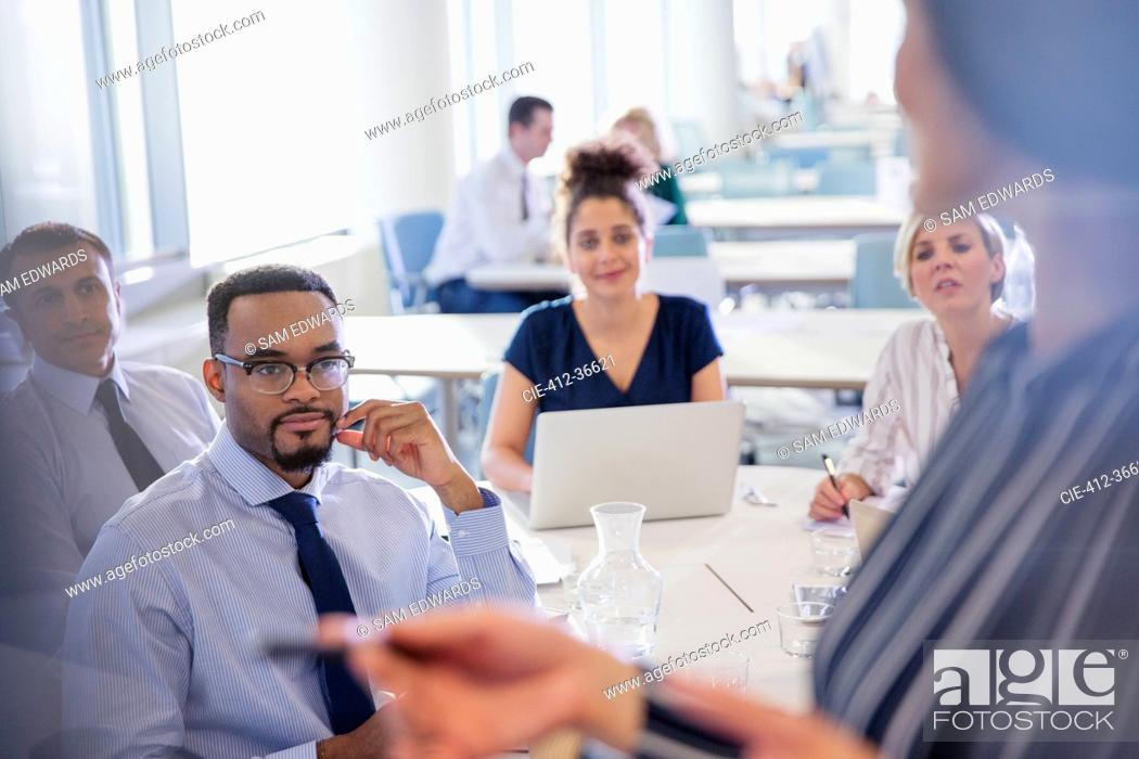 Stock Photo: Business people listening in conference room meeting.