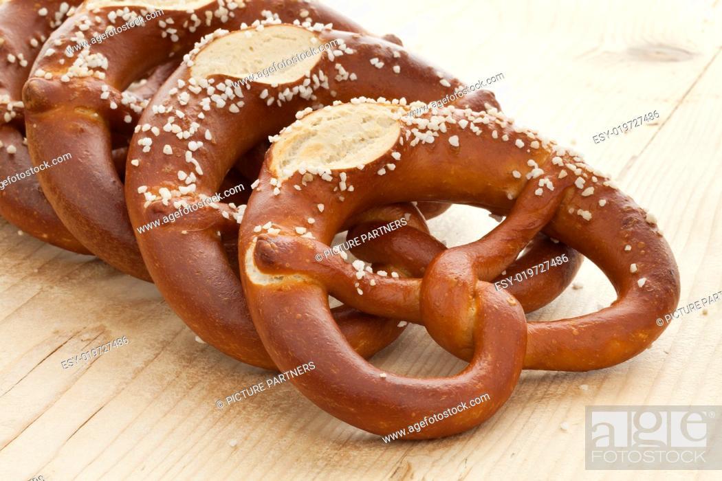 Stock Photo: Fresh soft pretzels with salt.