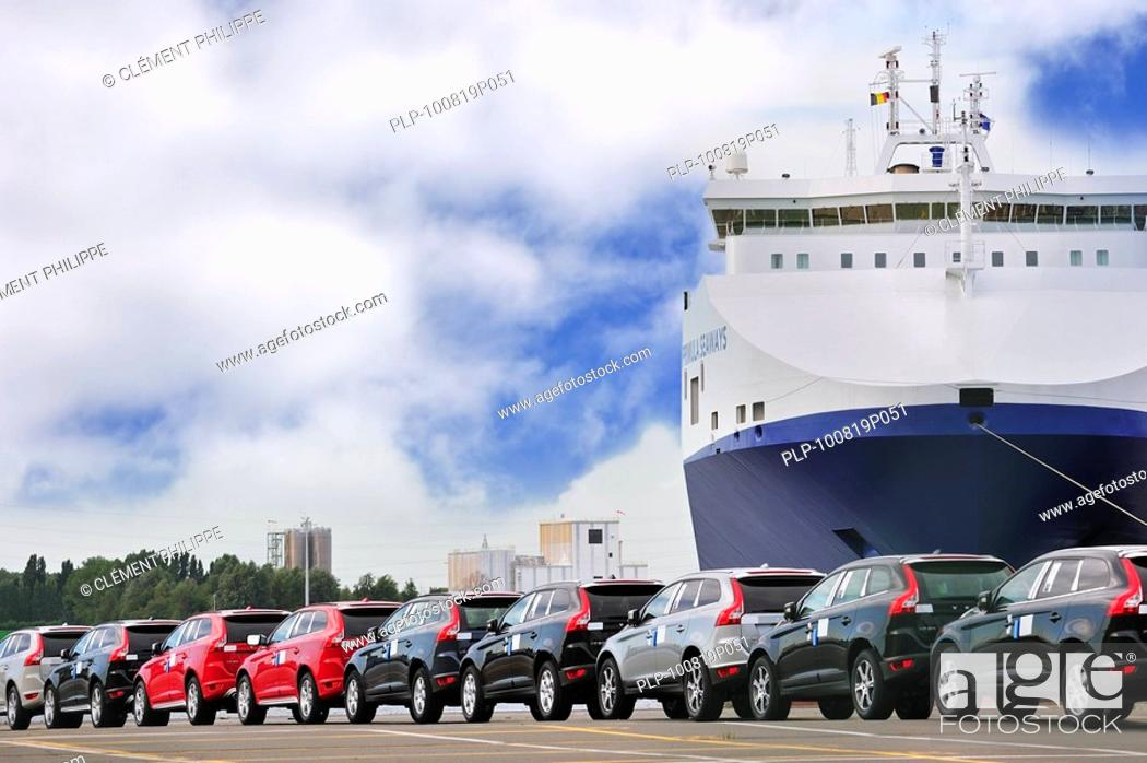 Stock Photo: Vehicles from the Volvo Cars assembly plant waiting to loaded on the roll-on/roll-off / roro ship at the Ghent seaport, Belgium.
