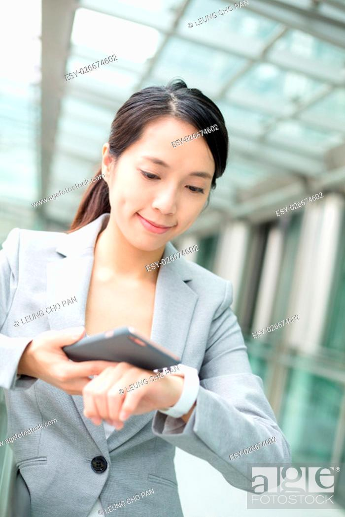 Stock Photo: Business woman use of smart phone and watch.