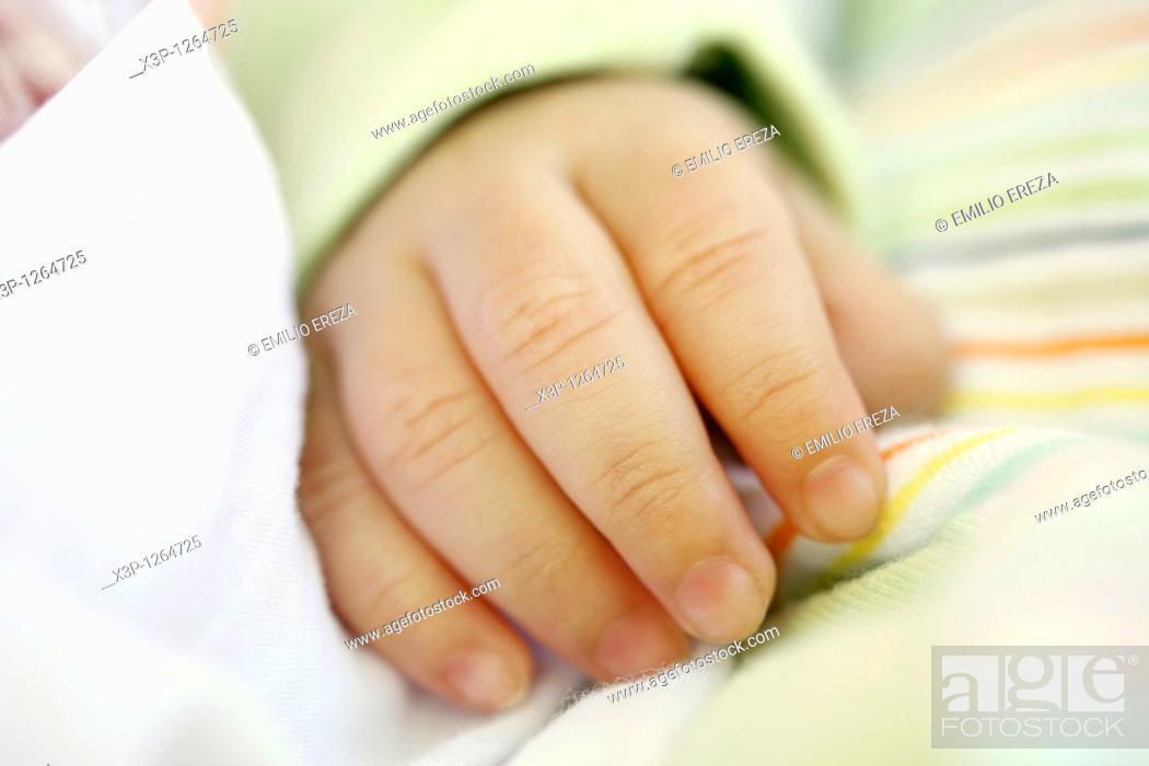 Stock Photo: Newborn hand.