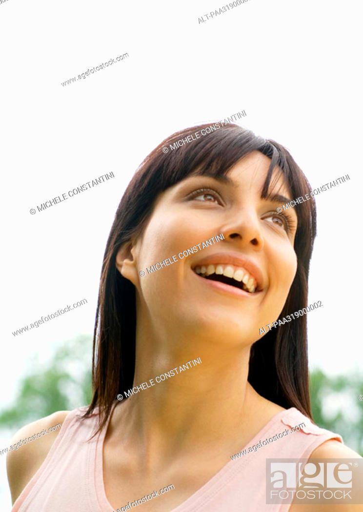 Stock Photo: Woman smiling and looking up, portrait.