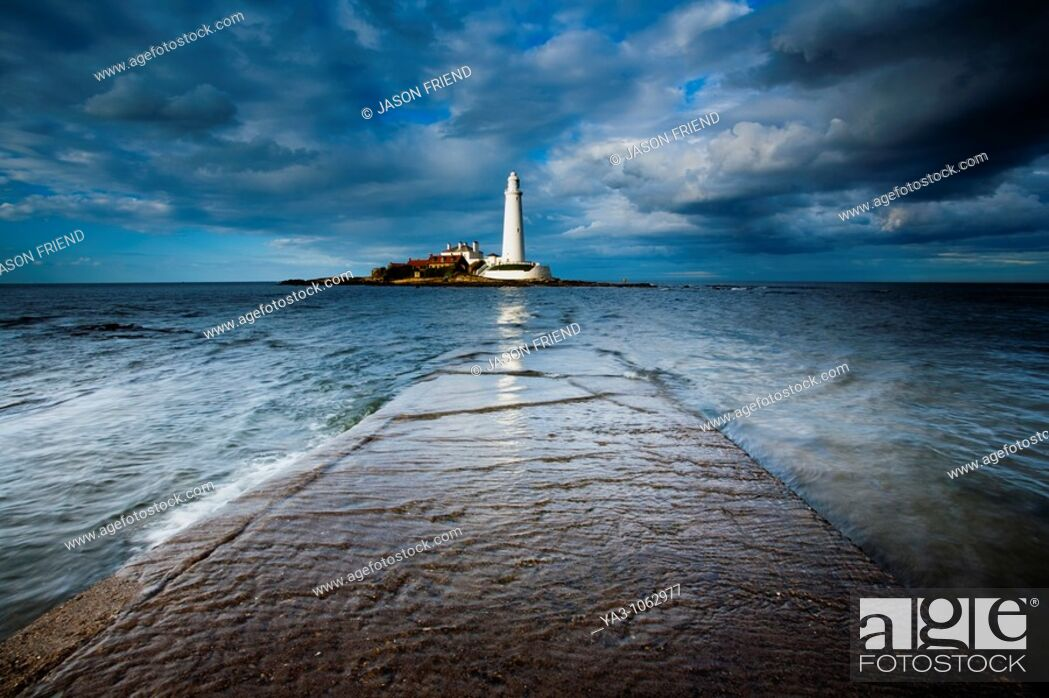 Stock Photo: England, Tyne and Wear, Whitley Bay  Incoming tide engulfs the causeway linking St Mary's Island & lifehouse to the mainland.