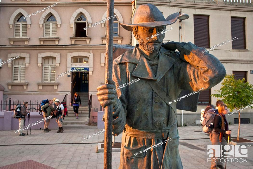 Stock Photo: Morning sunlight on pilgrim statue as pilgrims depart for a days walk in the city of Astorga along the Camino de Santiago.