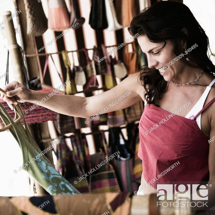 Stock Photo: Mid adult woman shopping in a clothing store.