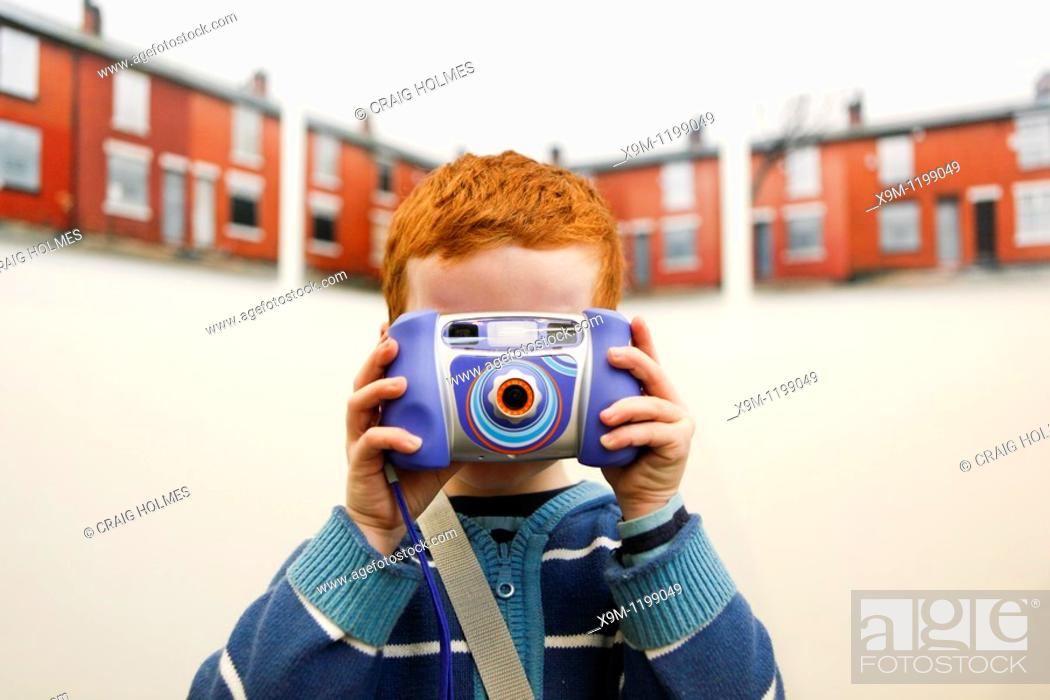 Stock Photo: Boy taking a picture. The New Art Gallery Walsall, West Midlands, England.