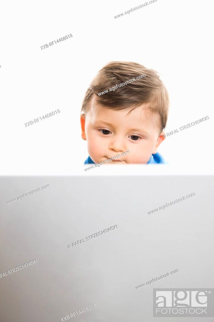 Stock Photo: Baby working on laptop.