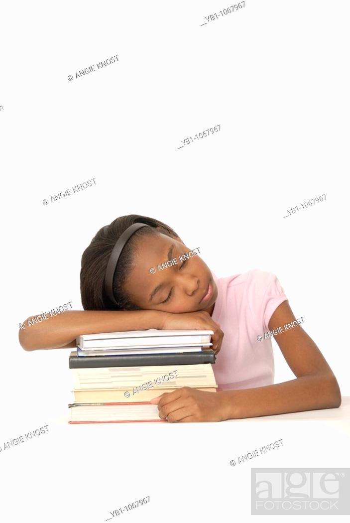 Stock Photo: Student falling asleep on stack of books.