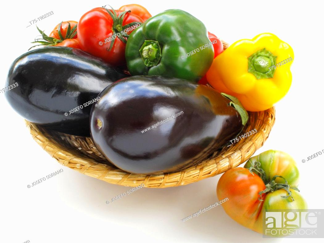 Stock Photo: Basket with aubergines, tomatoes and peppers,.