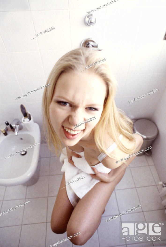 Woman Sitting In The Toilet Stock Photo - Download Image