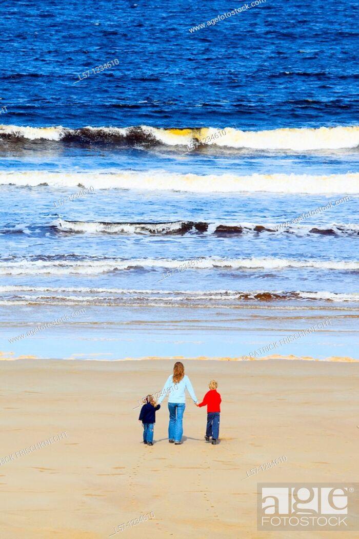 Stock Photo: family on sandy beach, Sutherland, Scotland.