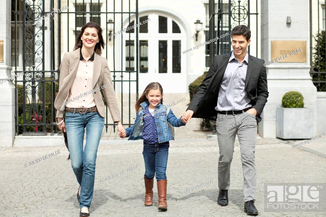 Stock Photo: Girl walking with her parents.
