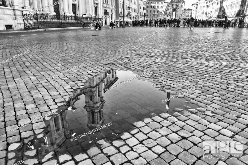 Stock Photo: Reflection in Navona Square in Rome (Italy).